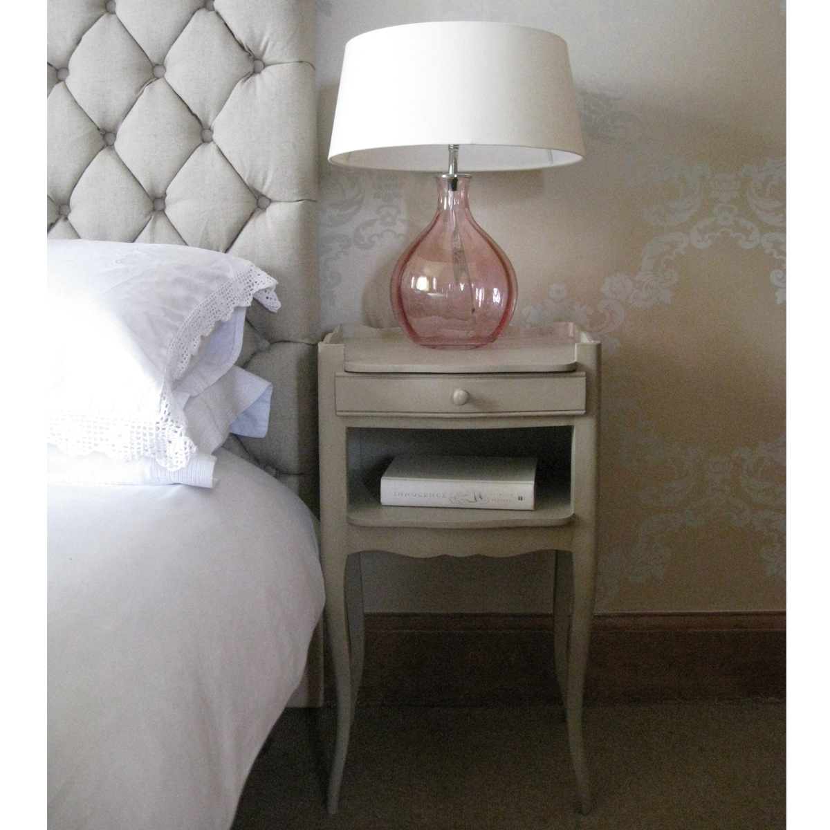 lamp, padded quilted headboard, bedside table