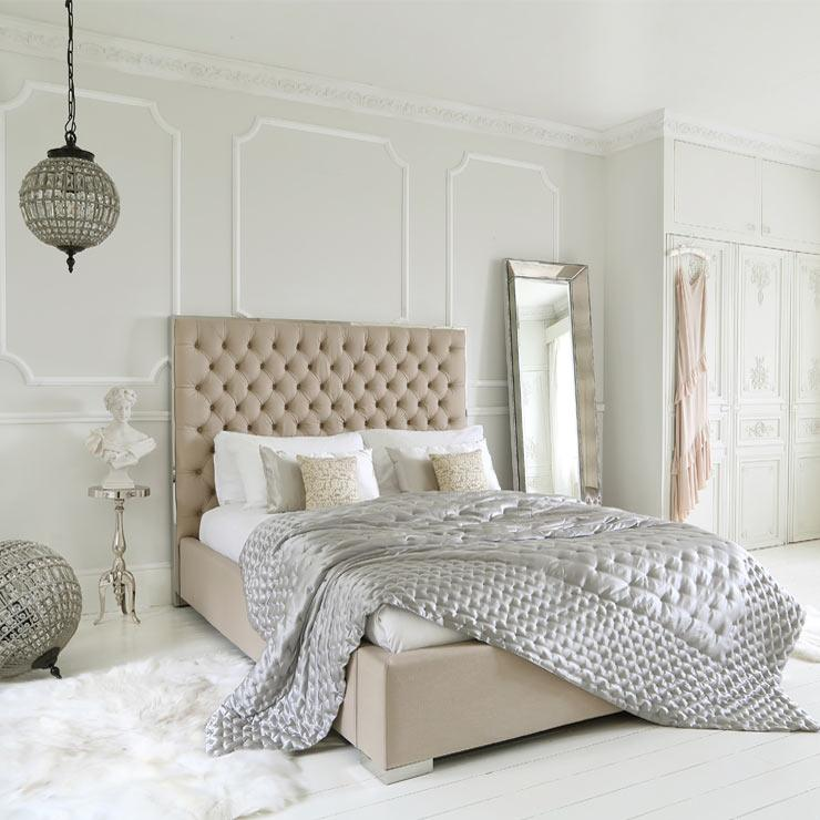 the French Bedroom Company Blog, How to Create a Romantic Boudoir for Valentines day. Interior design tips on fairylights, layers and flowers in the bedroom. French Romance. Featured: The French Bedroom Company Boutique Upholstered Bed with silk bedspread and large palace ballroom chandeliers